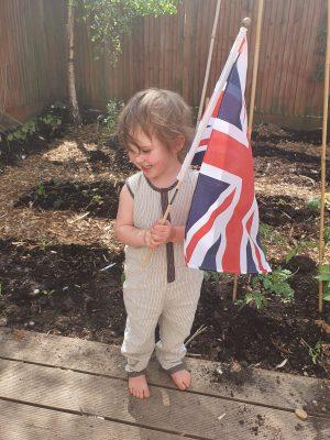 VE Day Flag Child Dig for Victory