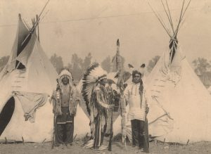 Black Foot, Standing Bear, Big Eagle, Sioux. Three members of the Sioux tribe pose in Indian Village, 1898 Boston Public Library